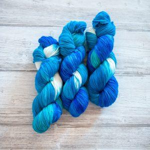 Three skeins of yarn in the colorway Cote d'Azur