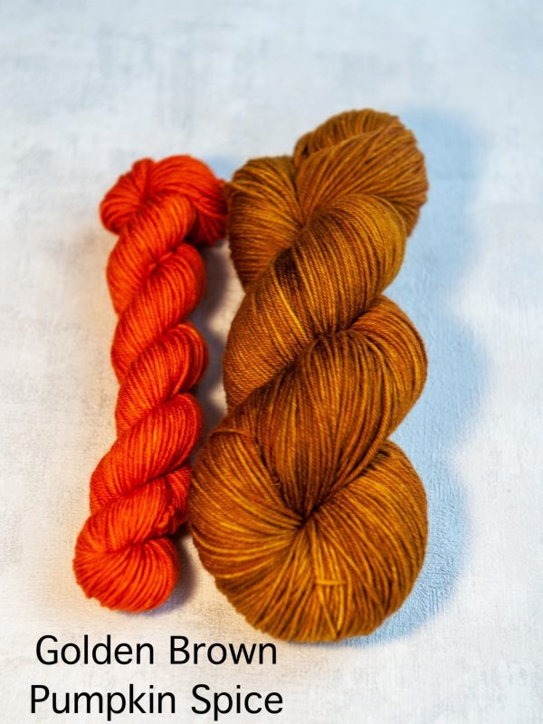 A sock set with the main skein in golden-brown and a mini skein in orange