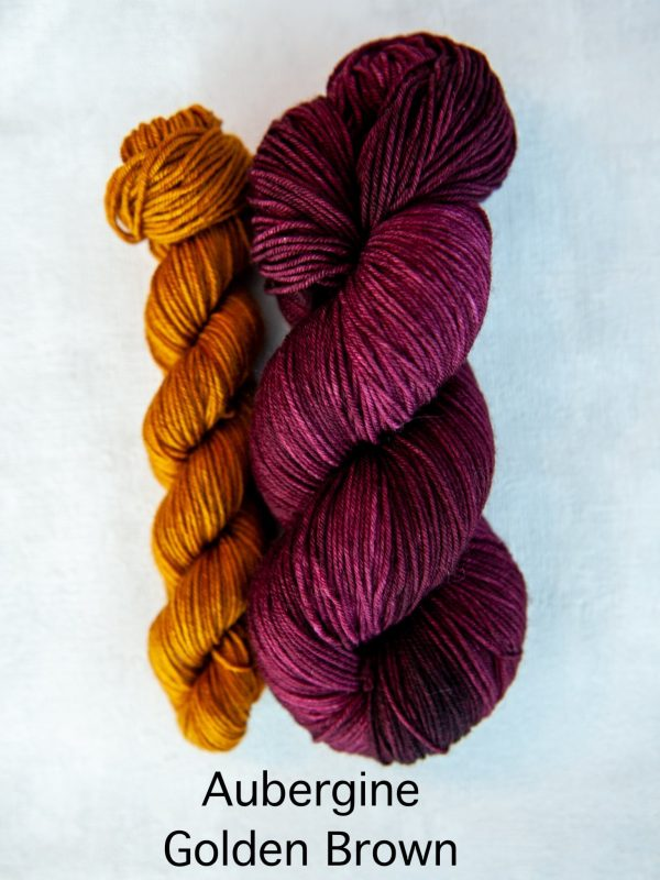 A sock set with the main skein in purple and a mini skein in golden-brown