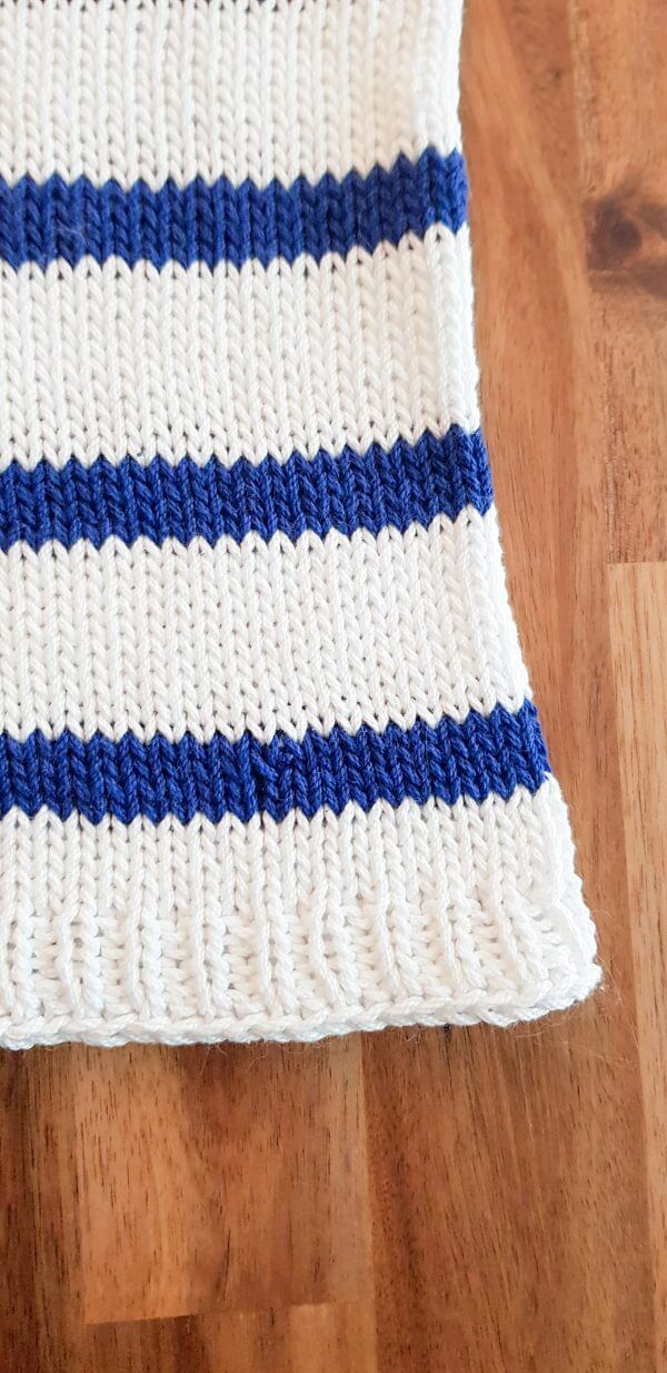 Close-up of the bottom right edge of the Harbor Top, showing two stripes and the ribbing