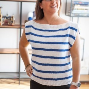 Woman wearing the Harbor Top in white with blue strips