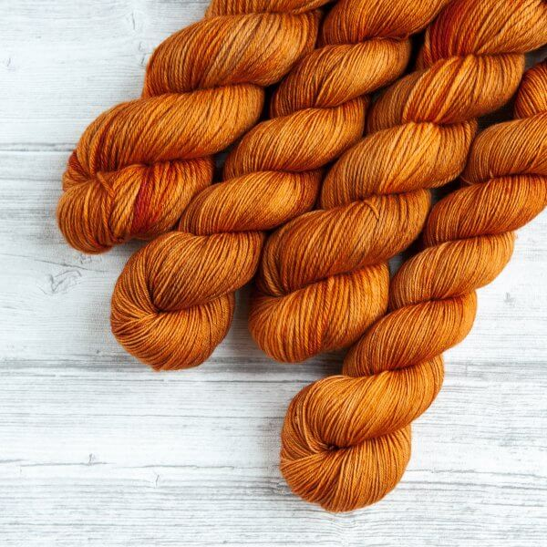 four skeins of yarn in the colorway 'Heilan Coo'