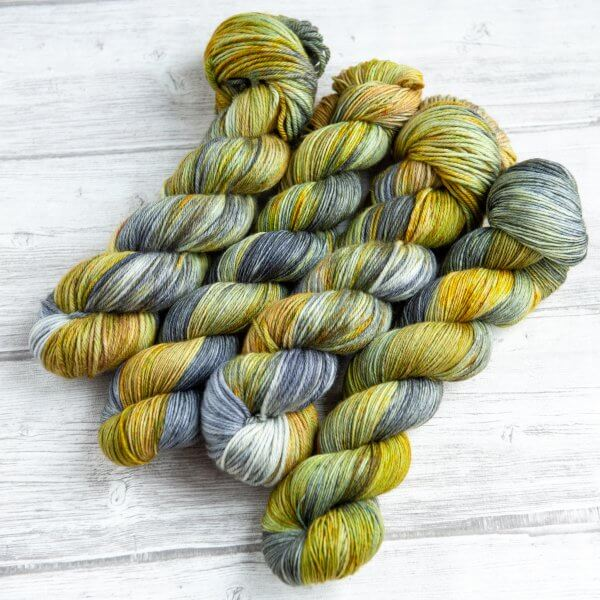 four skeins of yarn in the colorway 'Kilchurn Castle'