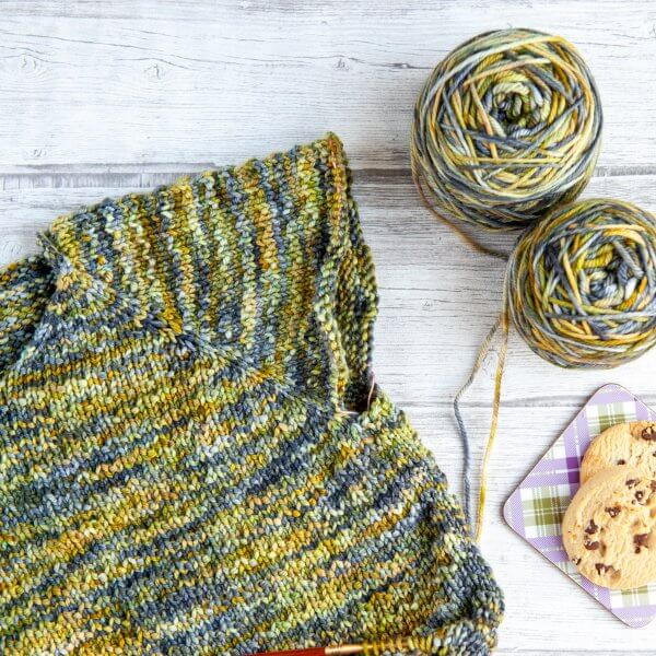 A partially knit sweater, knit with the colorway 'Kilchurn Castle'