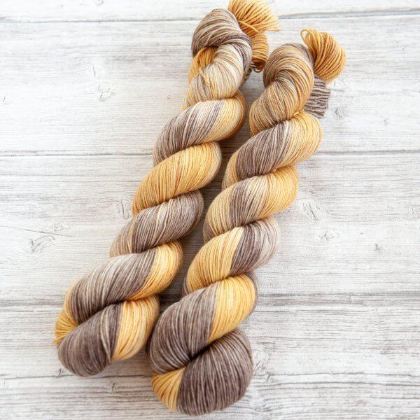 two skeins of yarn in the colorway 'Luskentyre Beach'