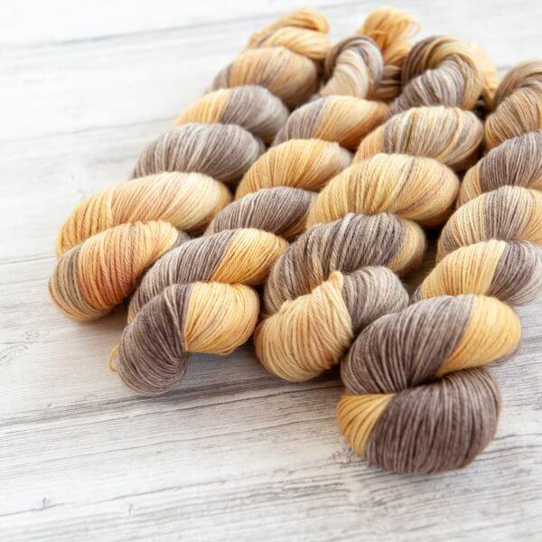 four skeins of yarn in the colorway 'Luskentyre Beach'
