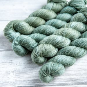 four skeins of yarn in the colorway 'Portree Harbour'
