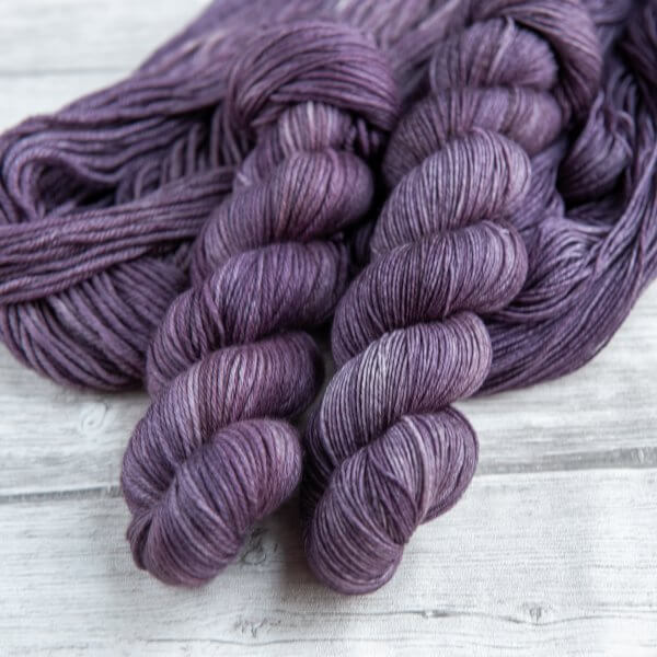 two skeins of yarn in the colorway 'Thistle'