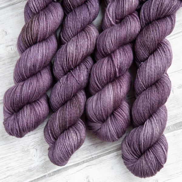 four skeins of yarn in the colorway 'Thistle'