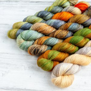 A skein of each of the variegated colorways of the Kilt-y Pleasures collection